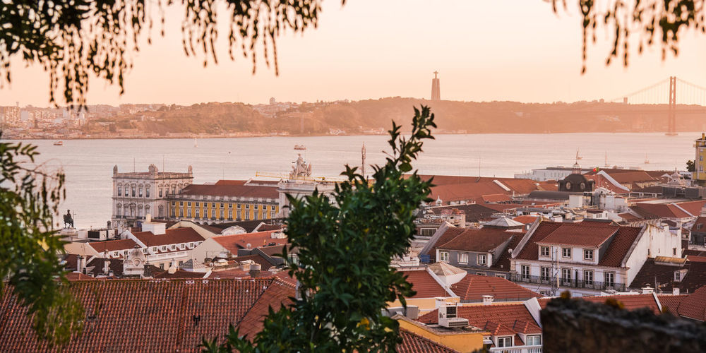 EyeEm Best Shots EyeEmNewHere Sunset_collection Travel Travel Photography View Views Architecture Building Exterior Built Structure High Angle View Lisbon Nature No People Outdoors Roof Scenics Sea Sky Sunset Travel Destinations Tree View From Above Viewpoint Water