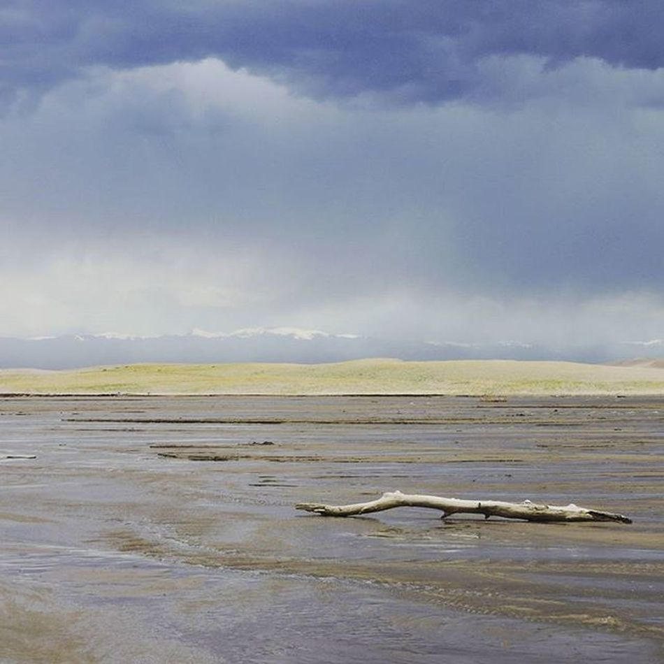 Spring thunderstorms over Medano Creek in Great Sand Dunes National Park, Colorado Photo from: May 2015 Medanocreek Rainshadow Greatsanddunes Greatsanddunesnationalpark Spring Rain Thunderstorms Colorado Water Weather Nature Hiking Landscapes Sanddunes Sand