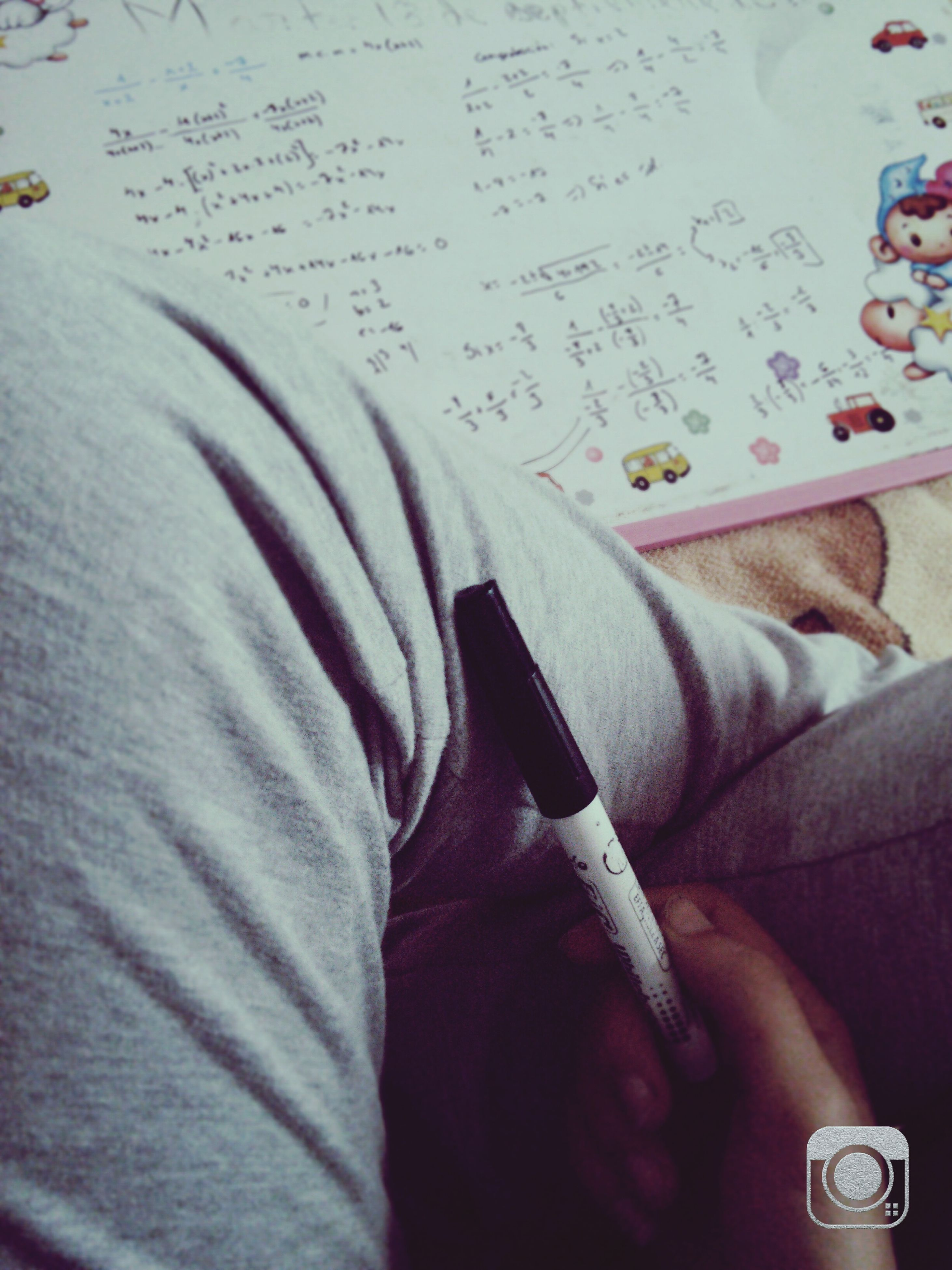 indoors, communication, book, text, close-up, education, bed, western script, paper, high angle view, person, part of, pen, table, technology, wireless technology, writing