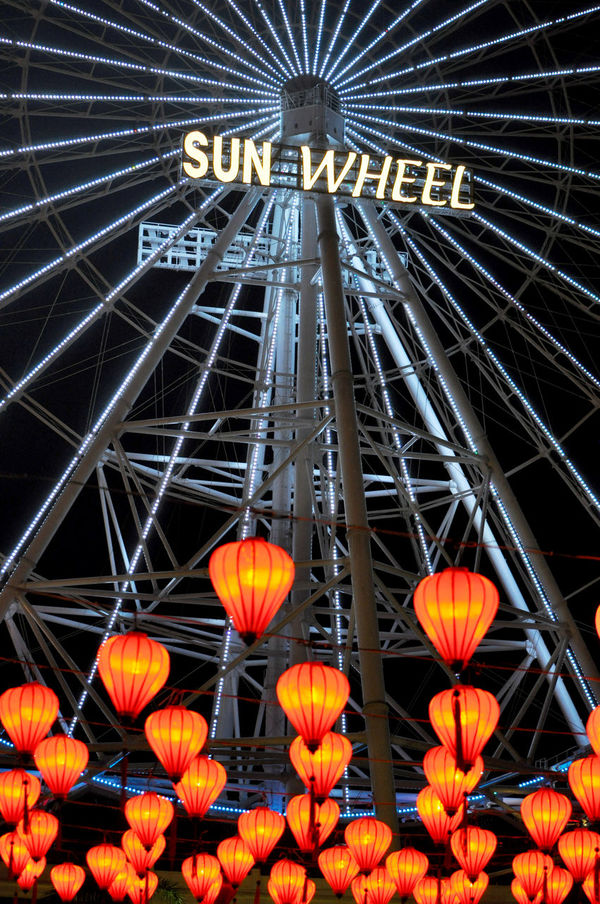 Sun Wheel and traditional lanterns at Asia Park in Da Nang, Vietnam. Asia Park Attractions Danang Family Ferris Wheels Fun Parks Lantern Low Angle View Night Life Night Lights Outdoors Rides Sun Wheel Theme Parks Tourism Tradition Vertical Vietnam