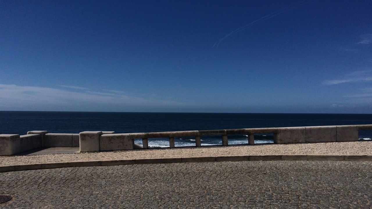 sea, water, horizon over water, blue, railing, day, tranquil scene, tranquility, outdoors, no people, nature, scenics, beach, sky, clear sky, beauty in nature
