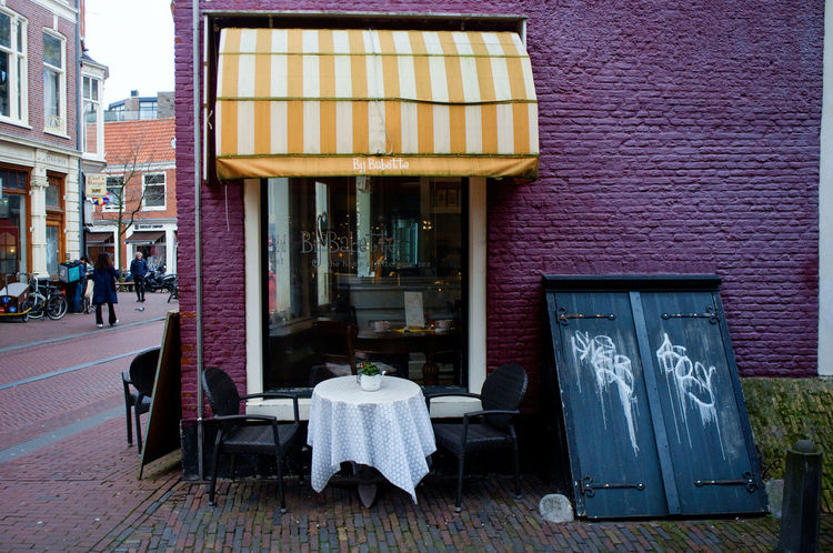 Colors Haarlem Noord Holland X100 Architecture Building Exterior Built Structure Chair Day Fujifilm_xseries One Person Outdoors People Real People Streetphotography