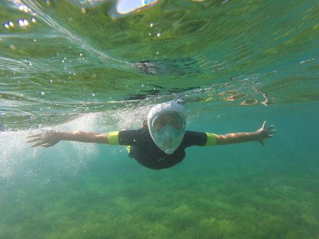Adult Close-up Day Happy Horizontal Hugging A Tree Leisure Activity Mask Motion One Person One Young Woman Only Outdoors People Person Snorkeling Snorkeling Mask Snorkelling Snorkling Swimming Swimming UnderSea Underwater Vacations Water Young Adult
