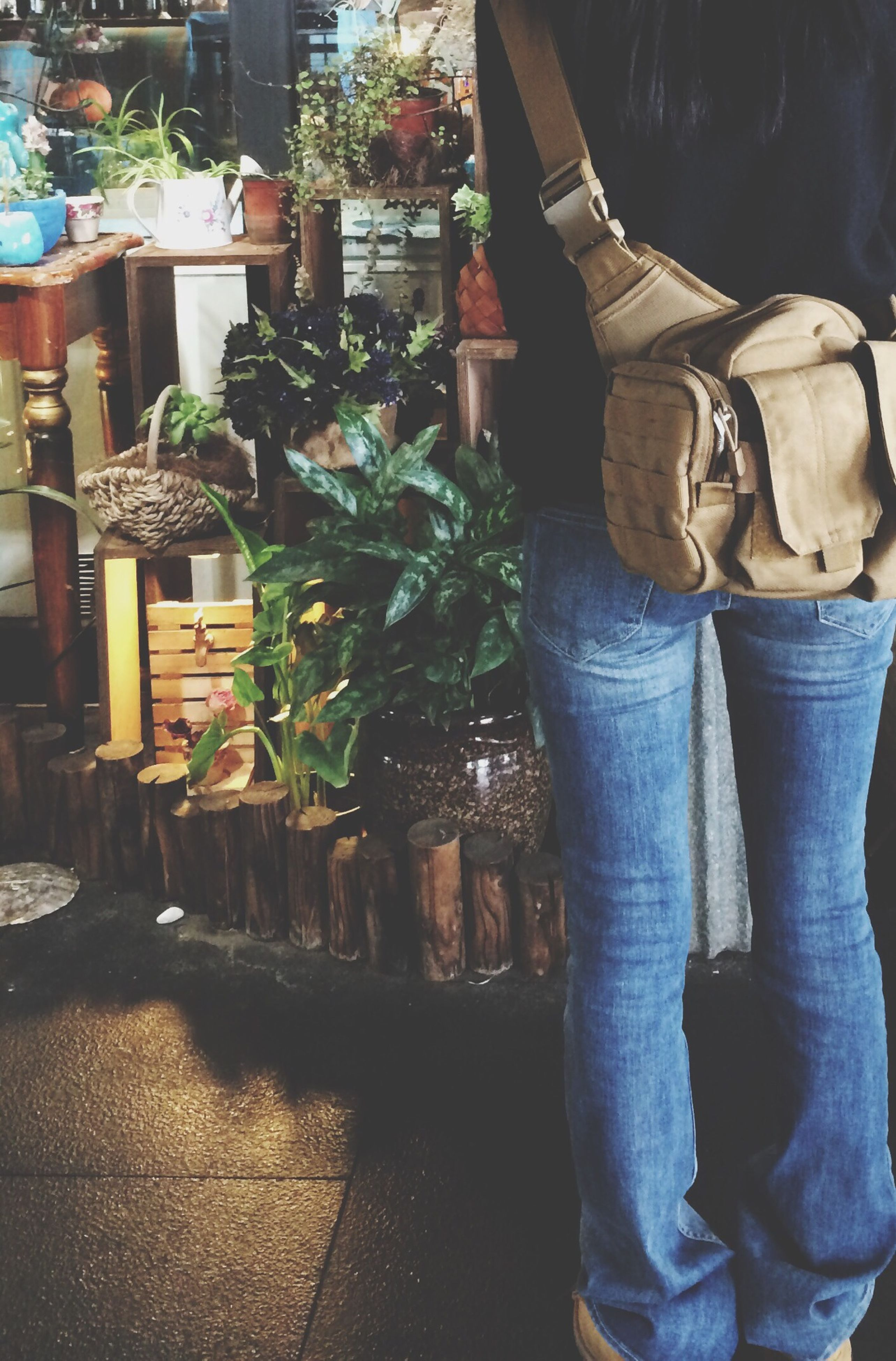 lifestyles, standing, men, retail, low section, for sale, casual clothing, person, market, market stall, leisure activity, potted plant, freshness, food and drink, shoe, outdoors
