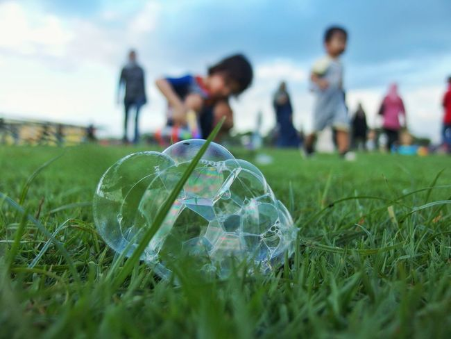 bubble alone ready to pop foreground focus Bubbles EyeEmNewHere Macro Bubbles Bubble Playtime Activity Funtimes Kids Having Fun Kids Playing Kidsphotography Grass Day Soccer Close-up People Nature Sky Outdoors Fragility