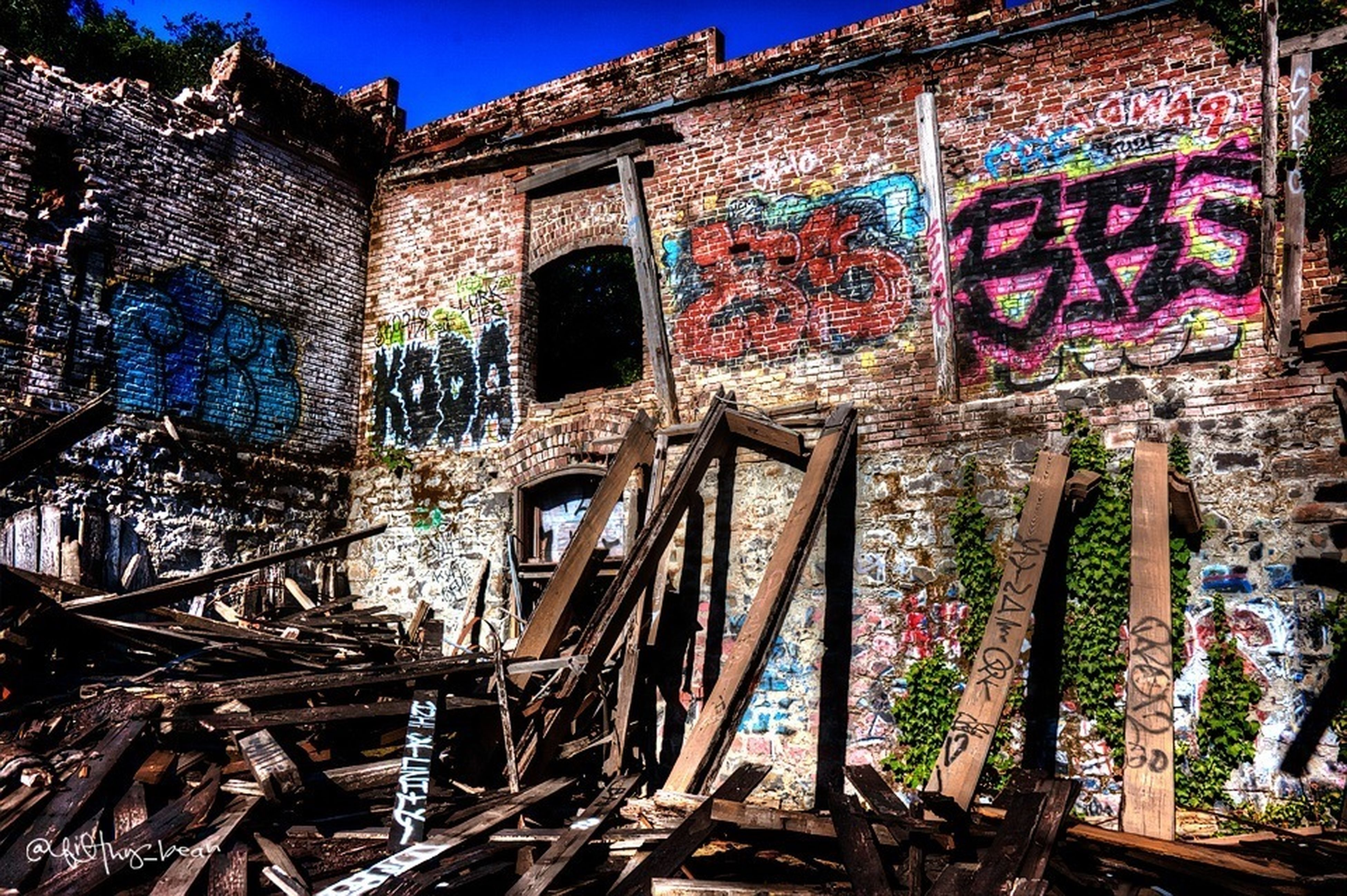 architecture, built structure, abandoned, building exterior, run-down, damaged, obsolete, deterioration, graffiti, old, weathered, bad condition, house, wall - building feature, destruction, blue, ruined, day, building, broken