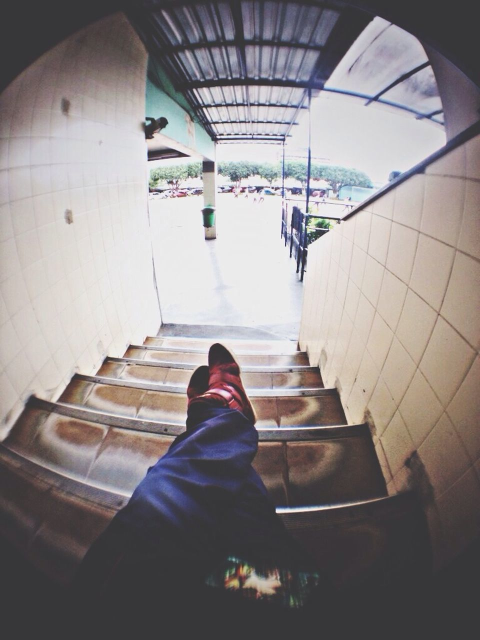 real people, steps, staircase, shoe, one person, human leg, indoors, low section, steps and staircases, standing, transportation, high angle view, rear view, women, lifestyles, sitting, men, day, human body part, architecture, people
