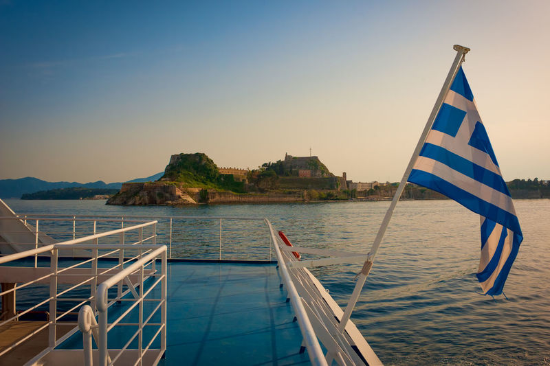Greek flag on the boat in front of the Corfu castle Cityscape Clear Sky Corfu CORFU ISLAND Day Flag Greece National Icon Nautical Vessel No People Outdoors Patriotism Sky Water