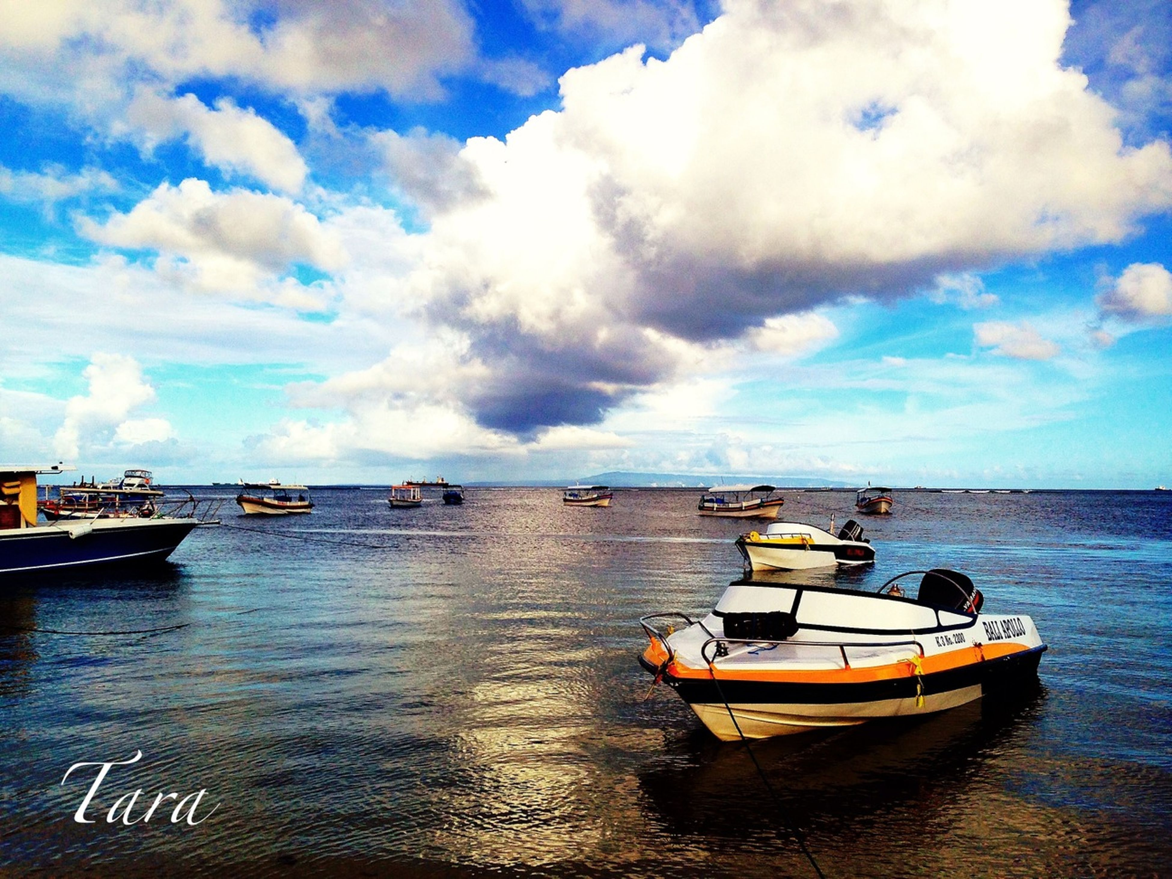 nautical vessel, transportation, mode of transport, boat, water, moored, sky, sea, cloud - sky, waterfront, cloud, tranquil scene, tranquility, travel, cloudy, nature, scenics, beauty in nature, sailing, rippled