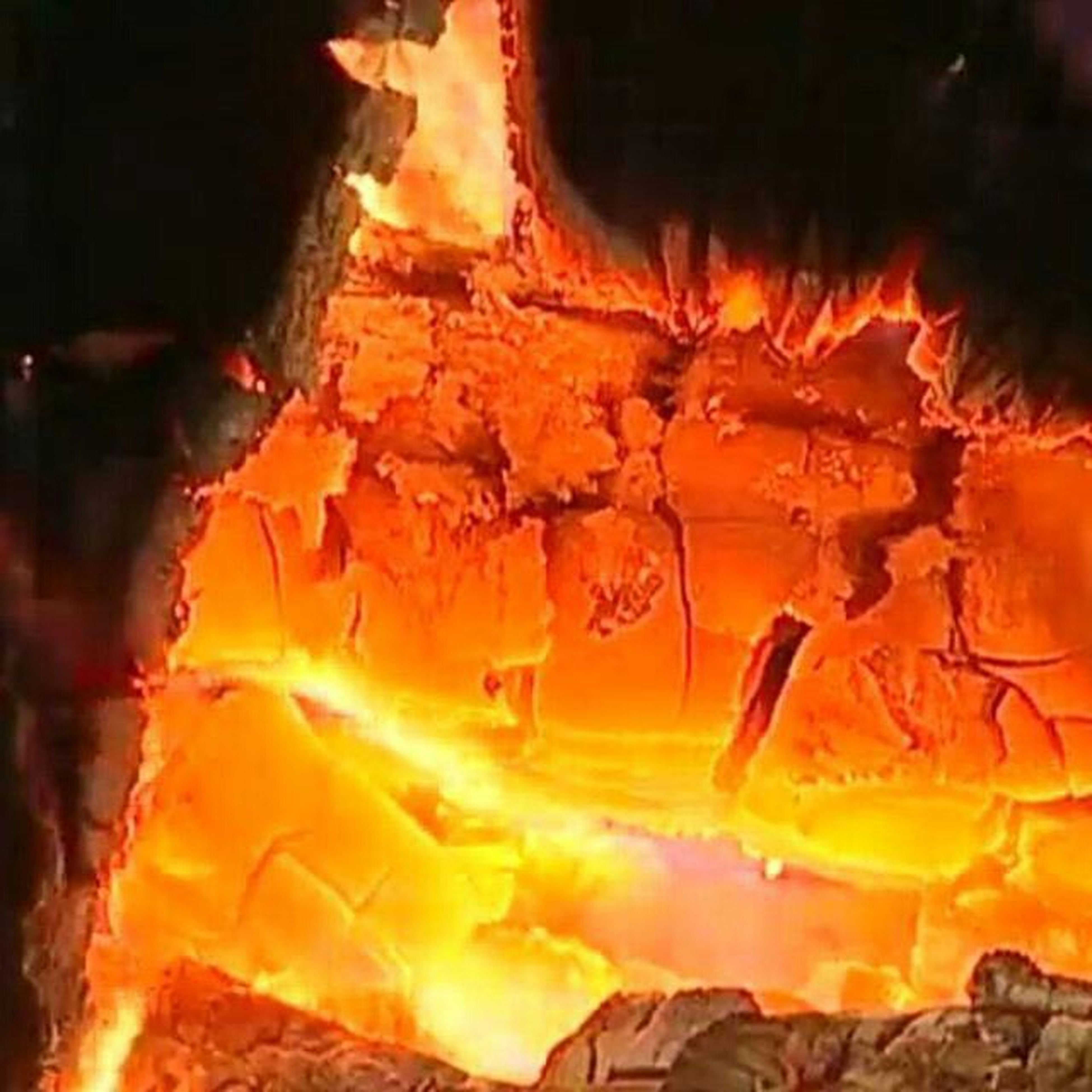 burning, flame, fire - natural phenomenon, heat - temperature, night, bonfire, glowing, illuminated, orange color, firewood, fire, campfire, cave, rock - object, close-up, motion, heat, rock formation, no people, outdoors