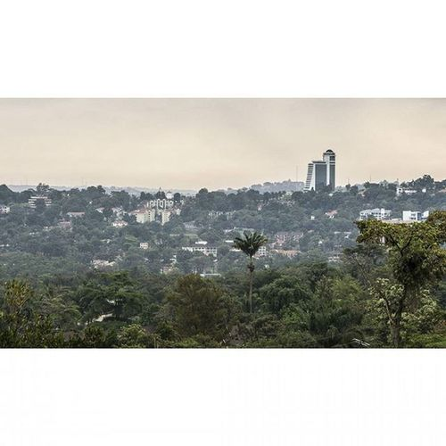 Part of the Kampala skyline with the Hilton in the distance. The unfinished hotel can be seen from almost anywhere in Kampala and I can only imagine the view from the highest point in and around the city. Travel TalesFromKampala Cityscape Skyline Eastafrica