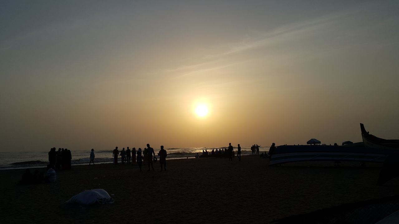 sunset, beach, sun, sea, nature, silhouette, sand, vacations, large group of people, sky, tourism, beauty in nature, scenics, outdoors, water, travel destinations, men, horizon over water, people