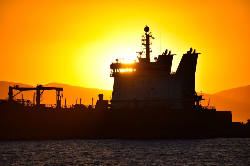 Sunset Silhouette Orange Color Sea Sky Waterfront Water Freight Transportation Nautical Vessel Industry Sun Outdoors Transportation No People Ship Shipping  Commercial Dock Nature Scenics Oil Industry