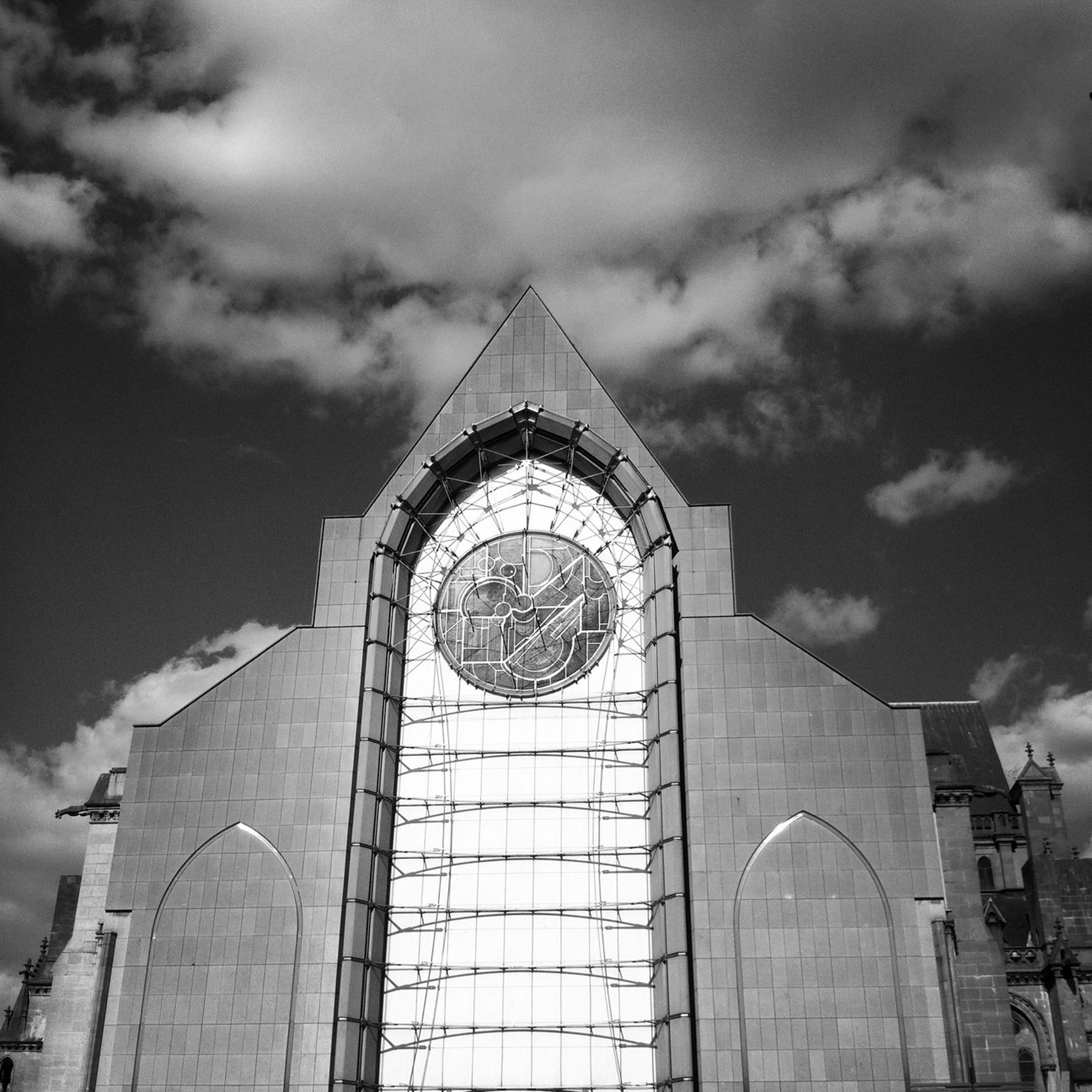 architecture, built structure, low angle view, building exterior, sky, cloud - sky, arch, cloudy, cloud, church, religion, day, place of worship, outdoors, window, no people, history, tower, dome