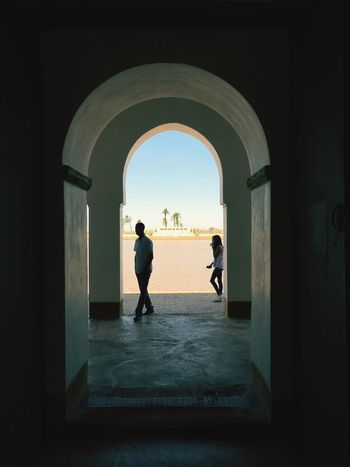 Menara - Into The Light Lovers Contrast Contrast And Lights Blazing Sun Marrakech Morocco Marrakech Arch Gateway Romance Love Games Love Light And Shadow Light Sun Exit EyeEm Selects Arch Indoors  Architecture Archway Entrance Built Structure Doorway Silhouette Day Togetherness Sky