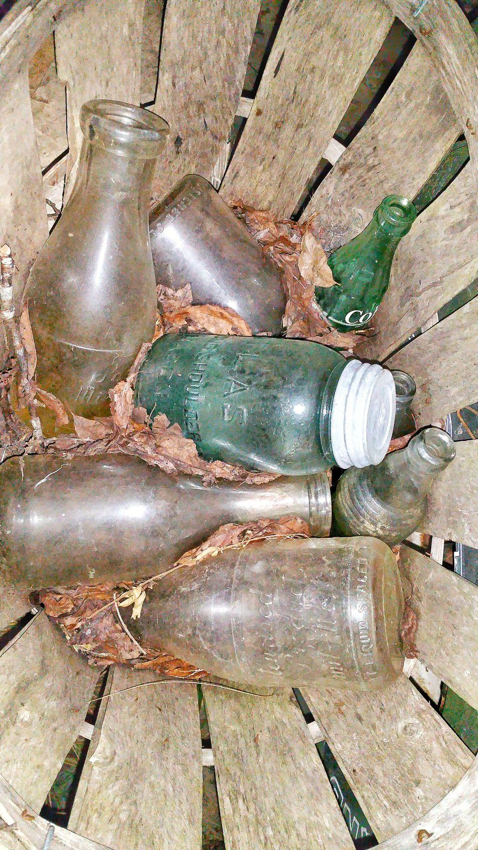 Antique Old Vintage Old Bottles Old Jars High Angle View Abandoned Wooden Basket Drink Bottles Mason Jar Old Glassware Glassware Old Milk Bottle Milk Jugs Dried Leaves Times Gone By Times Past Vintage Item Old Wine Bottle
