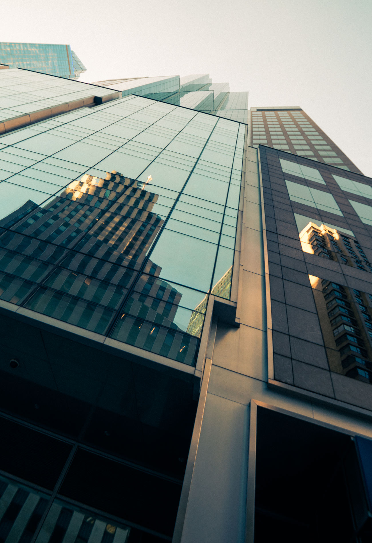Reflection Architecture Building Exterior Built Structure City Corporate Business Day Growth Low Angle View Modern No People Outdoors Reflection Sky Skyscraper Tall Window Window Washer