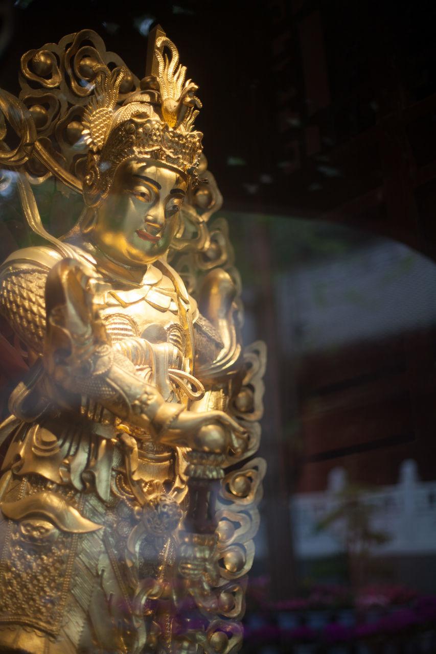 Golden Goddess Statue In Temple