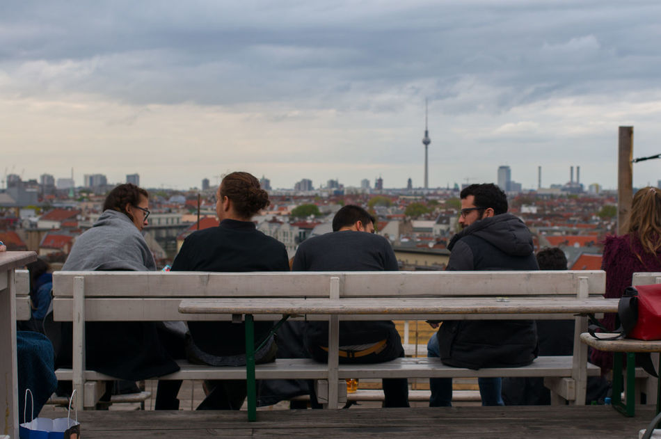 Day 55 - photo made in Berlin during while meeting friends from Uni. 365 365project Berlin Cafe City Cloud - Sky Day Eye4photography  EyeEm Gallery Food And Drink Friendship Leisure Activity Lifestyles Men Outdoor Cafe Outdoors Real People Rear View Roof Top Sitting Sky Table Togetherness Women