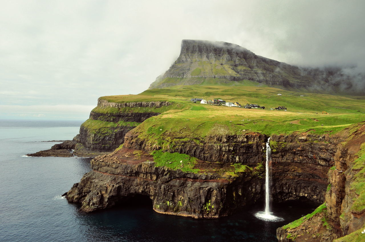 Beauty In Nature Clouds Faroe Islands Fog Hill Idyllic Majestic Mountain Nature Outdoors Sea Sky Tourism Tranquil Scene Travel Destinations Water Waterfall
