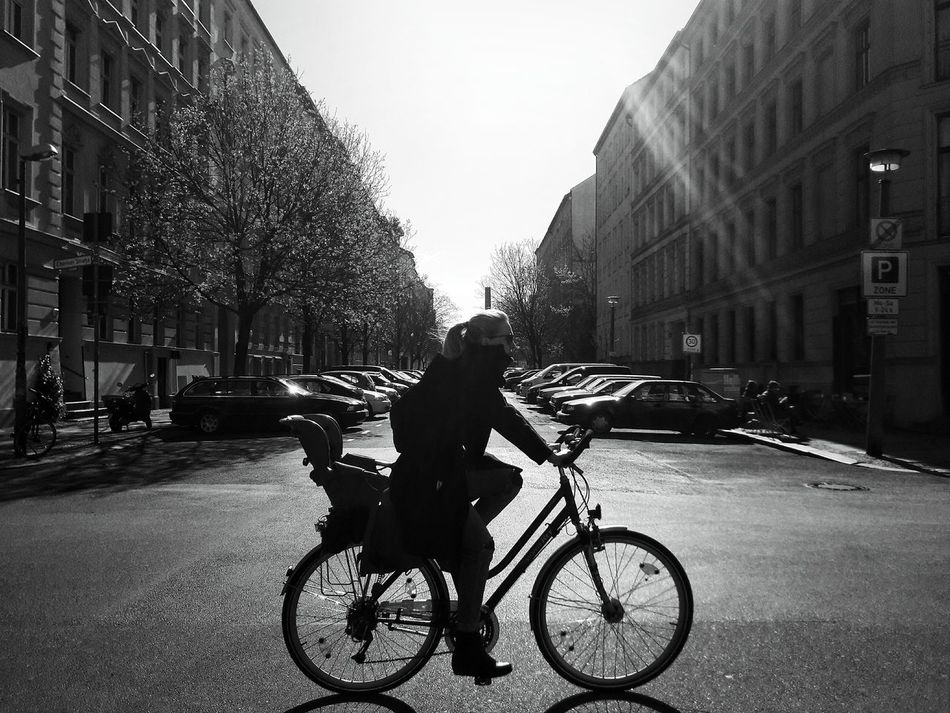 Be ahead of your time Bicycle Cycling Outdoors Riding Street Full Length One Person City From My Point Of View Urban Lifestyle Eye4photography  Berlin Photography Springtime Urban Photography EyeEm Best Shots My Fucking Berlin Black And White Blackandwhite Monochrome Street Photography Shadow And Light Welcome To Black
