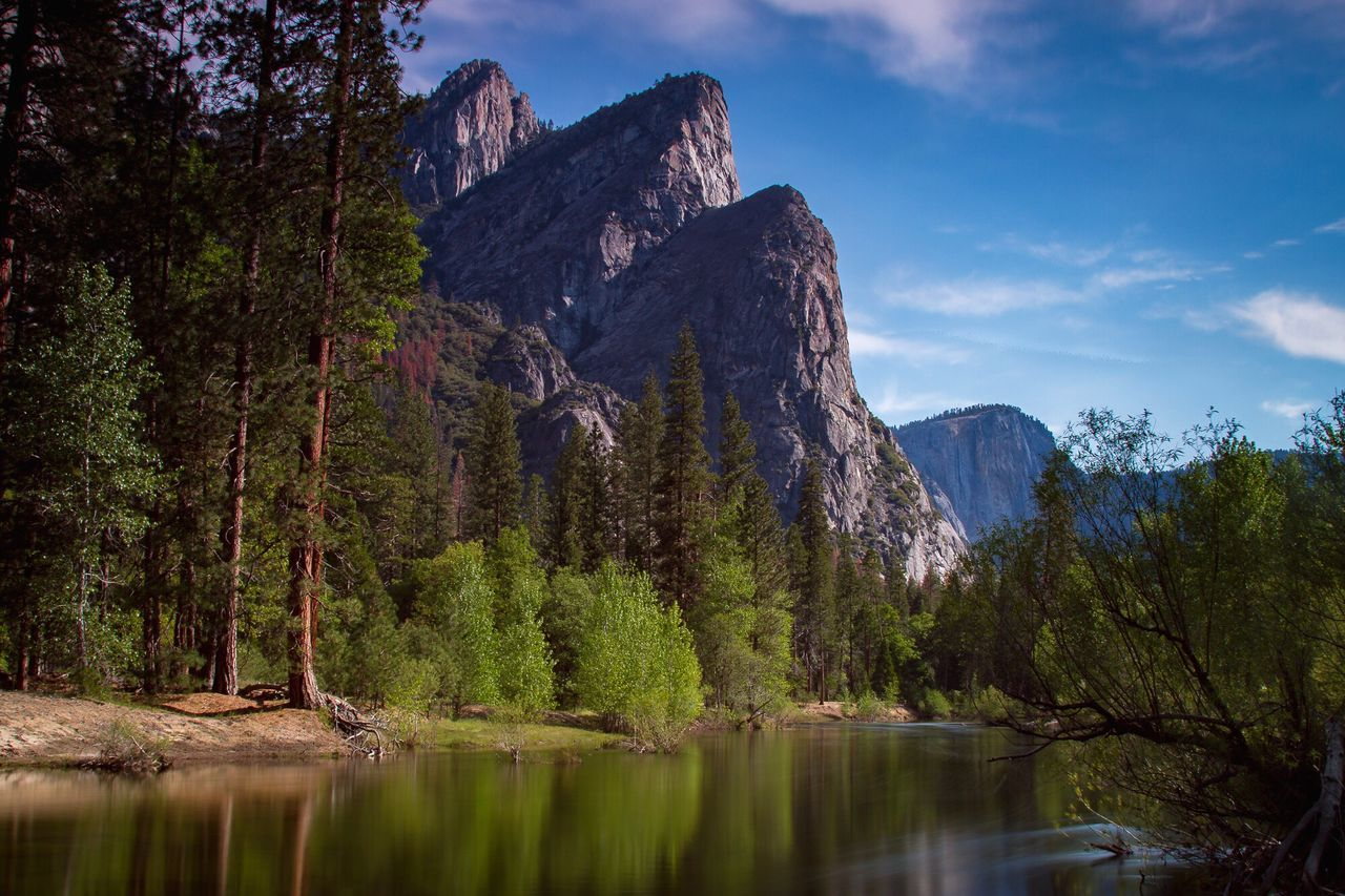 Scenic View Of River By Rocky Mountain