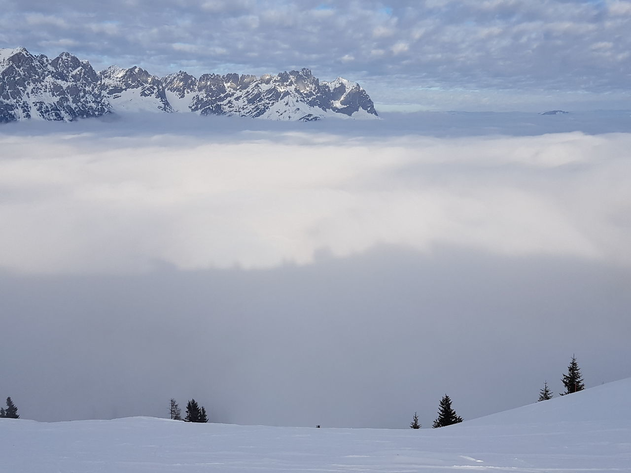 clouds over mountains Snow Clouds Scheffau Clouds And Sky Above The Clouds Ski Ski Resort  Austria Alps Alpine Mountain Range Outdoors Wilderness Nature Beauty In Nature Landscape Cold Temperature Mountain Snow Scenics Winter