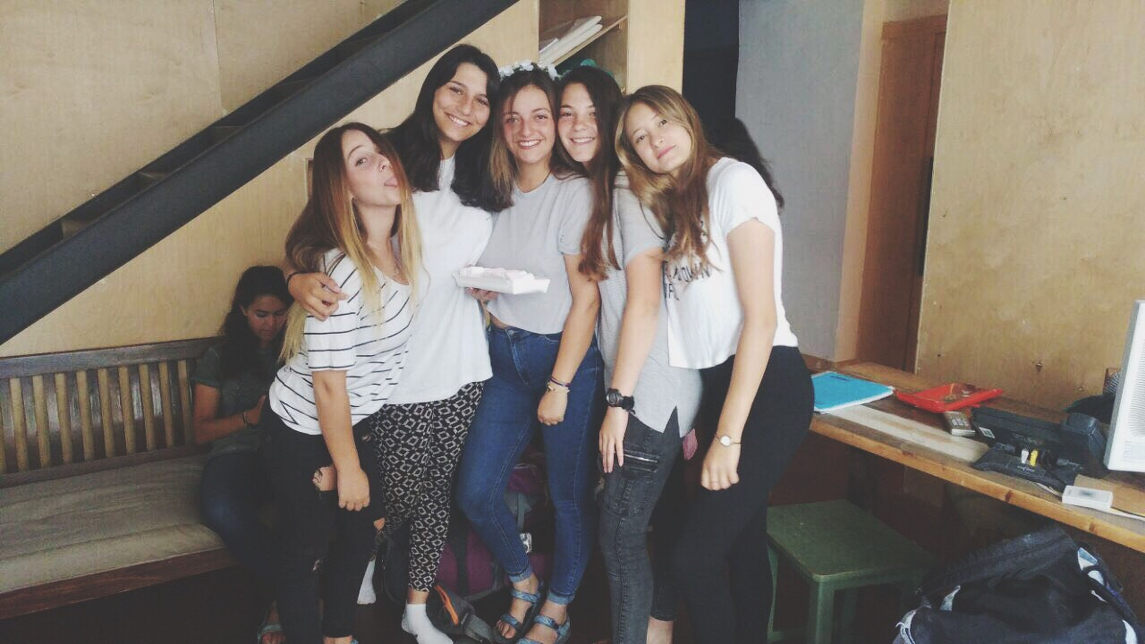standing, young women, young adult, leisure activity, casual clothing, front view, smiling, togetherness, real people, full length, lifestyles, indoors, fashion, happiness, portrait, friendship, looking at camera, day, beautiful woman, bonding, wireless technology, technology