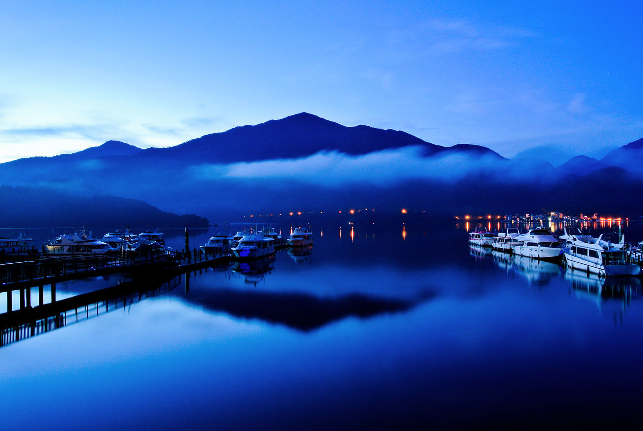 Beauty In Nature Blue Sky Boat Cold Temperature Jetty Lake Lakeside Mist Misty Misty Morning Moon Sun Lake Morning Scenery Morning Sky Mountain Mountain And Lake Mountain Range Mountains And Sky Nature Reflection Scenery Scenics Sky Sunrise Tranquil Scene Water