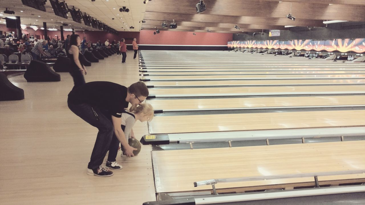 Full Length Real People One Person Lifestyles Childhood People Leisure Activity Tranquility Taking Photos Indoors  Bowling Alley Bowling Bowling Ball Father And Daughter Fatherhood  Daughter