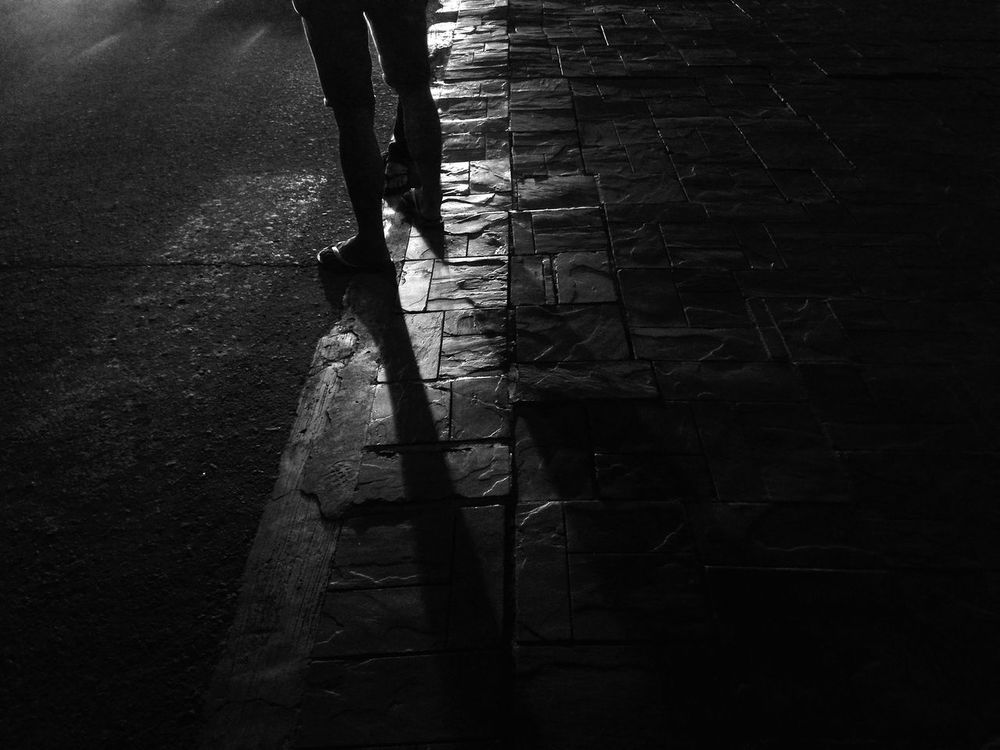 The Street Photographer - 2016 EyeEm Awards Street Photography Black And White Light And Shadow Shadows & Lights Chasing Light Light In The Darkness Light Chaser Urban And Street Black And White Photography Perspective Shadow Play The Following Monochrome Photography Welcome To Black