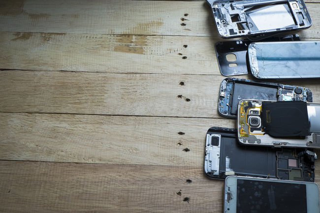 Broken smart phone with space in wooden texture background Backgrounds Board Brand Broken Broken Glass Cellphone Celphone Circuit Crack Damaged Electronic Glass Guaranty Handphone Lost Repair Spare Spareparts Tecnology Useless Wooden Wooden Table Wooden Texture