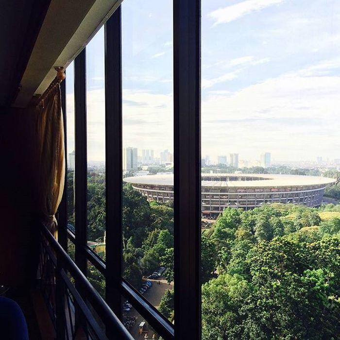 The Gelorabungkarno stadium at Senayan  area. View from the 16th floor. Sun Cloud sky beautiful scenery green nature tree stadium soccer jakarta indonesia hotel like4like followme I Love My City My Best Photo 2015