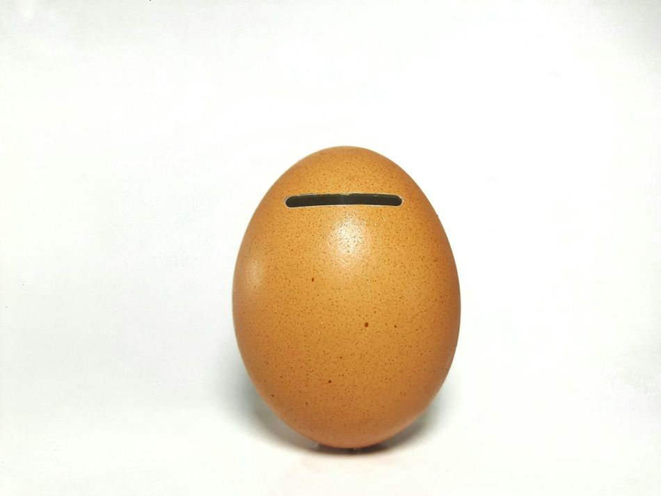 Egg piggy bank Egg Single Object Studio Shot Easter Piggy Bank Financial Business Finance Money Keep  Saving Collection Manipulated Debt Account Loan  Payment Coins Loan