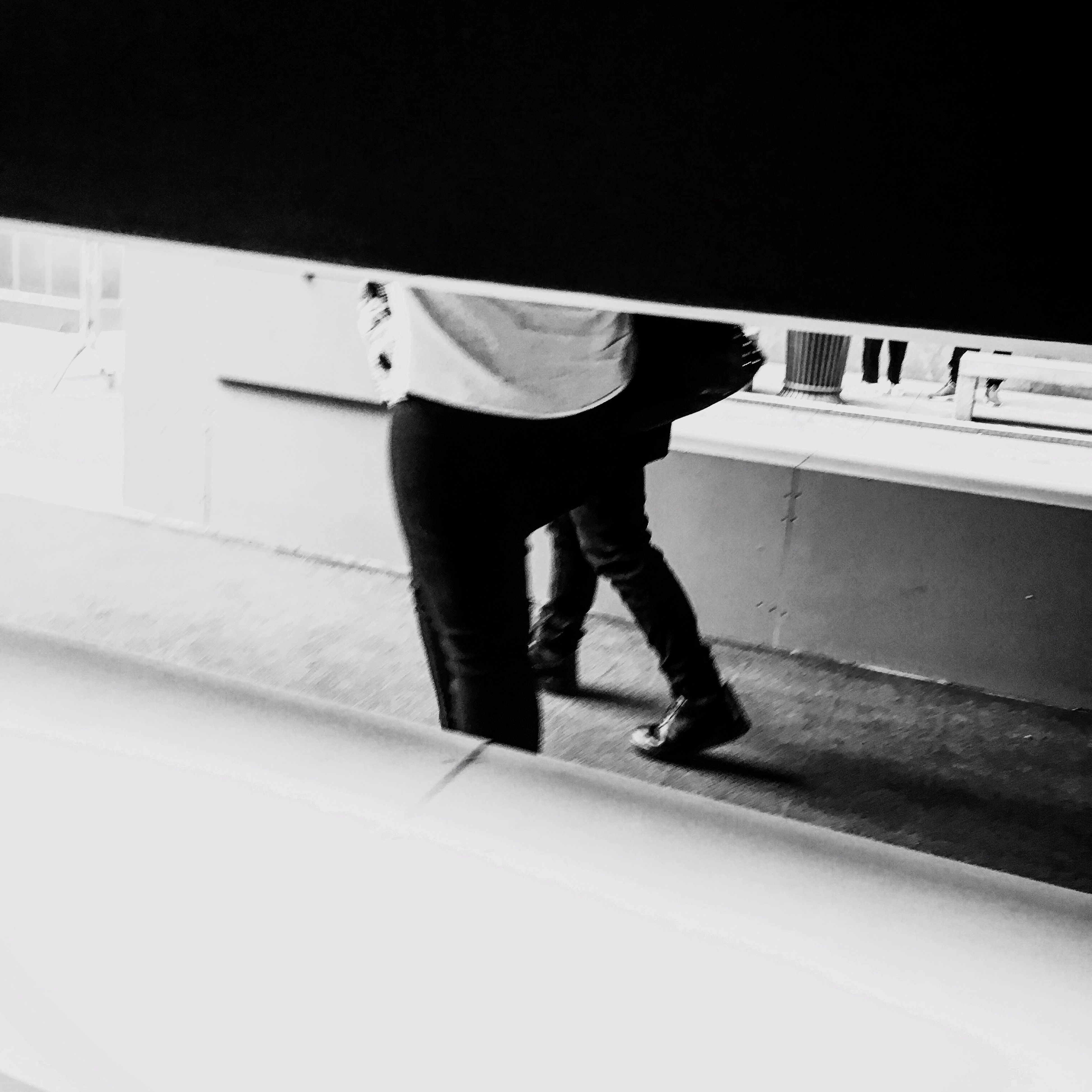 men, walking, lifestyles, low section, full length, standing, person, rear view, indoors, shadow, on the move, leisure activity, casual clothing, street, steps, shoe, sunlight