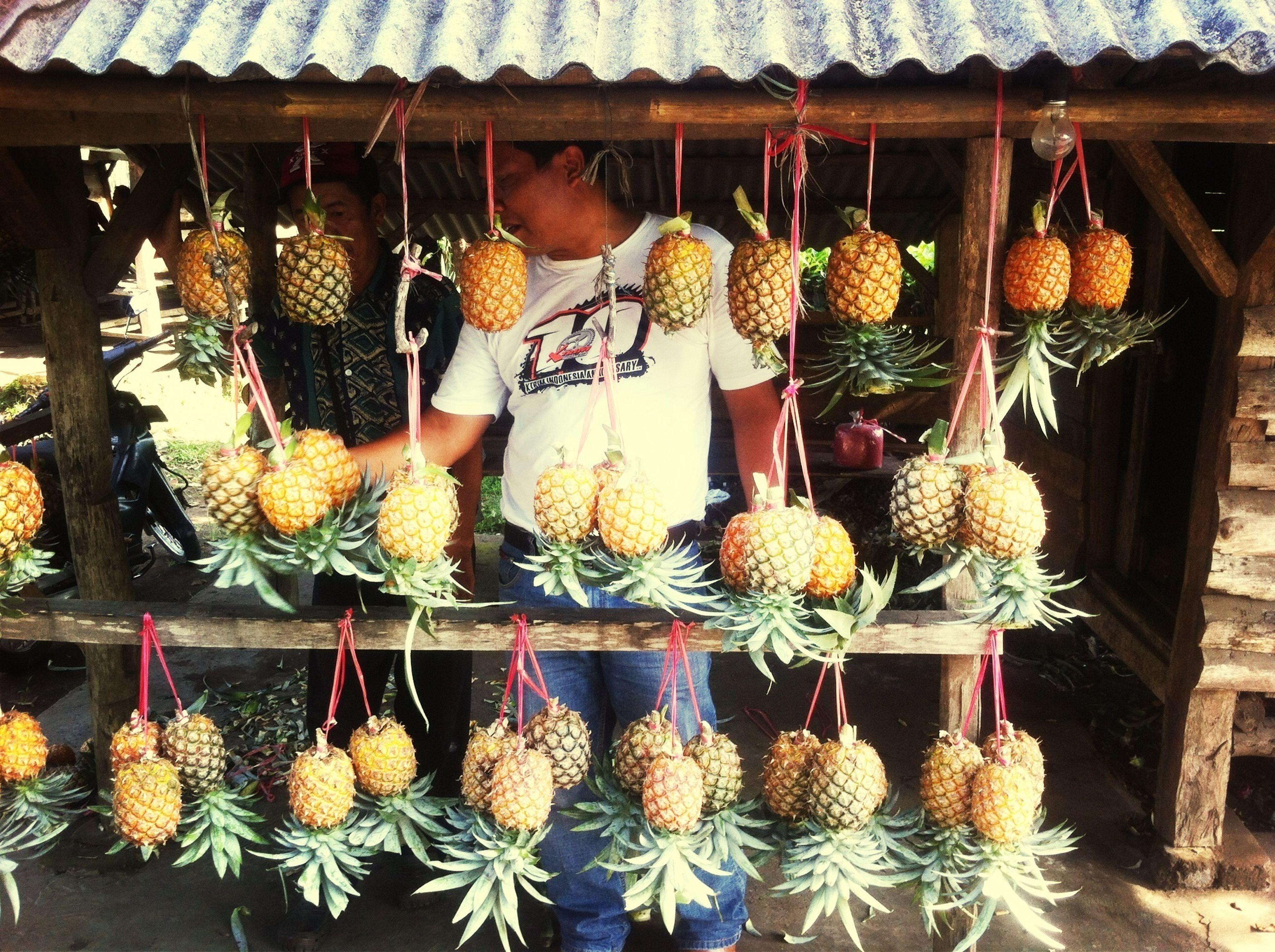 for sale, retail, freshness, abundance, market stall, market, variation, food, large group of objects, food and drink, choice, healthy eating, fruit, flower, basket, hanging, arrangement, display, vegetable, agriculture
