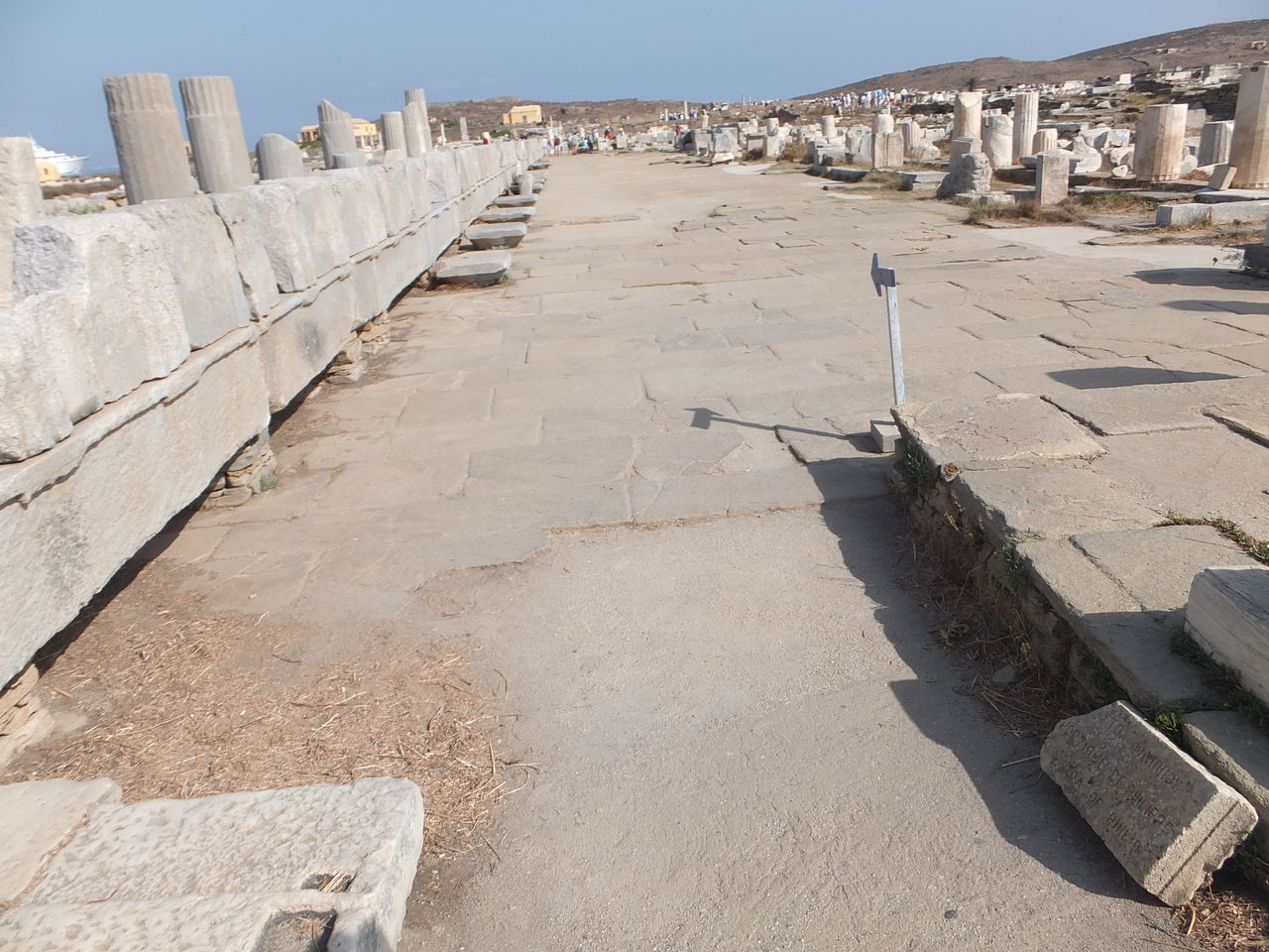 The Sacred Way Ancient Ruins Arid Climate Blue Sky Building Exterior Composition Delos Diminishing Perspective Full Frame Greece High Angle View History In A Row Incidental People Island Outdoor Photography Outdoors Sacred Place Shadow Stone Material Sunlight Sunny The Way Forward Tourism Tourist Attraction  Unoccupied Island