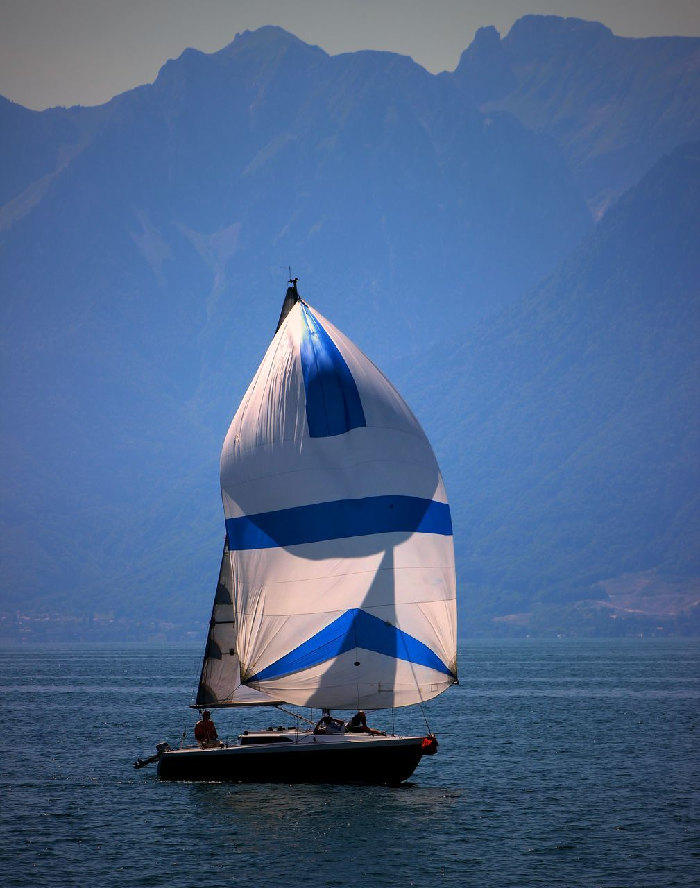 mountain, sea, nature, scenics, day, water, sky, beauty in nature, tranquility, outdoors, nautical vessel, no people, mountain range, horizon over water, sailing