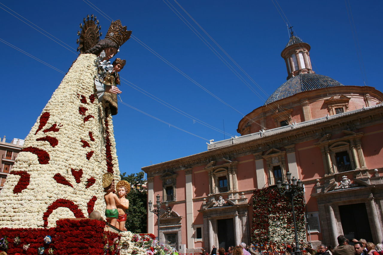 Her dress is made of fresh flowers. Architecture Building Exterior Capilla City Clear Sky Flowers History Place Of Worship Religion Sky Statue Tourism Travel Travel Destinations Valencia, Spain Virgen Virgen De Los Desamparados Millennial Pink