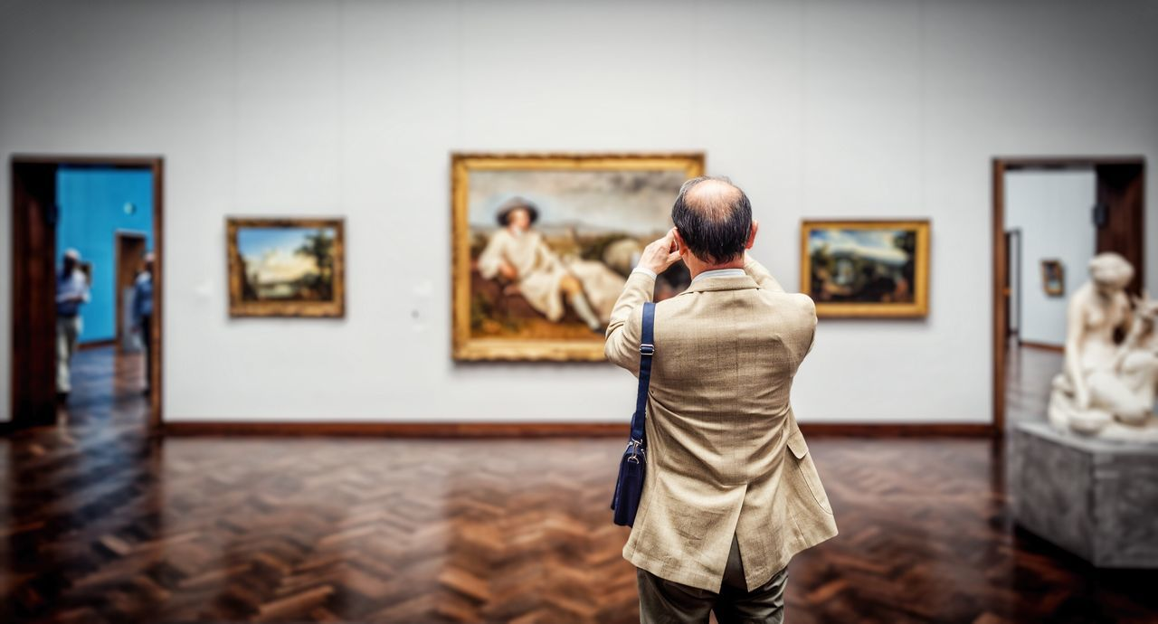 rear view, art and craft, picture frame, real people, paintings, museum, artist, men, indoors, leisure activity, lifestyles, women, fine art painting, arts culture and entertainment, one person, painted image