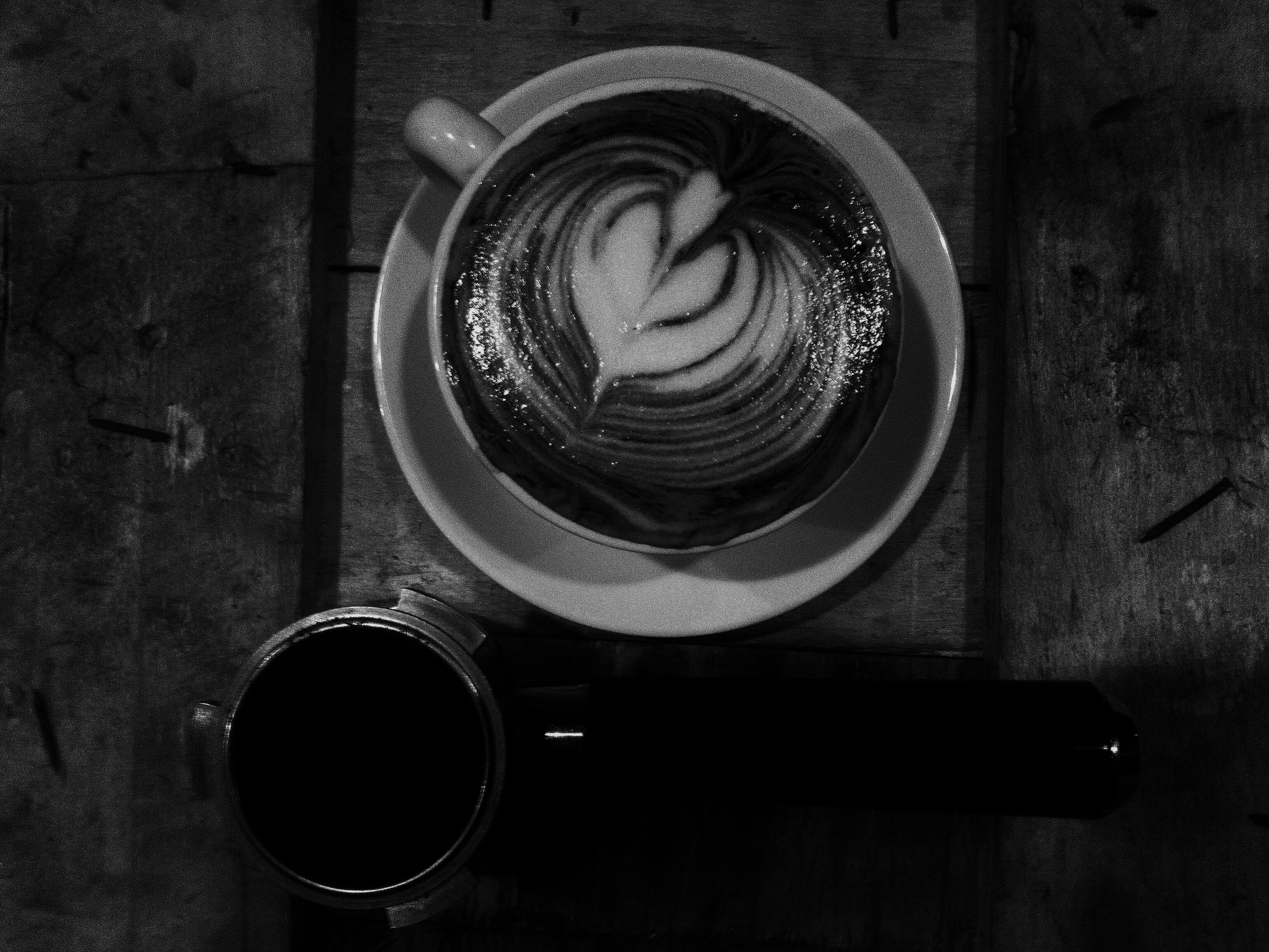 indoors, still life, close-up, table, coffee cup, directly above, high angle view, coffee - drink, no people, art, circle, creativity, wood - material, overhead view, drink, single object, art and craft, refreshment, food and drink, metal