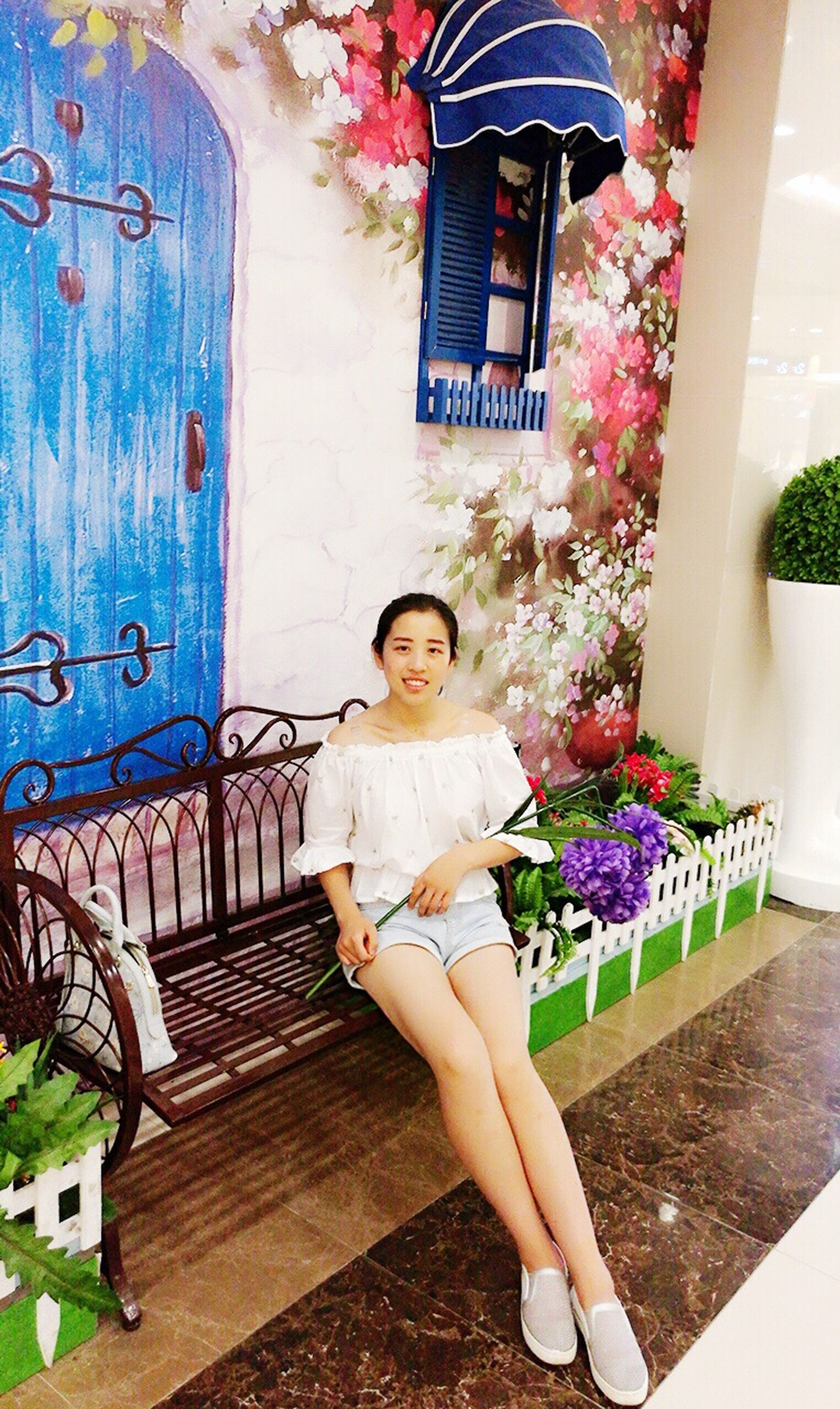 flower, built structure, person, casual clothing, full length, architecture, lifestyles, front view, potted plant, wall - building feature, house, plant, looking at camera, door, leisure activity, standing, building exterior, childhood