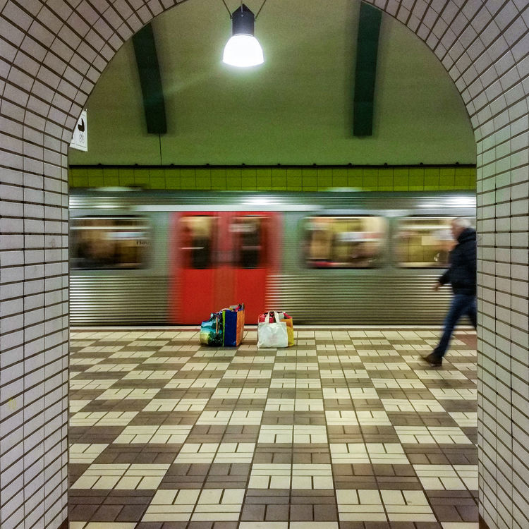 Blurred motion Adult Adults Only Architecture Blurred Motion City Life Day Early Morning Hamburg Hamburg Central Station Handy Photo Illuminated Indoors  Men Motion One Person People Public Transportation Rails Real People Speed Subway Station Subway Train Tracks Train Platforms Transportation Fresh On Market 2017