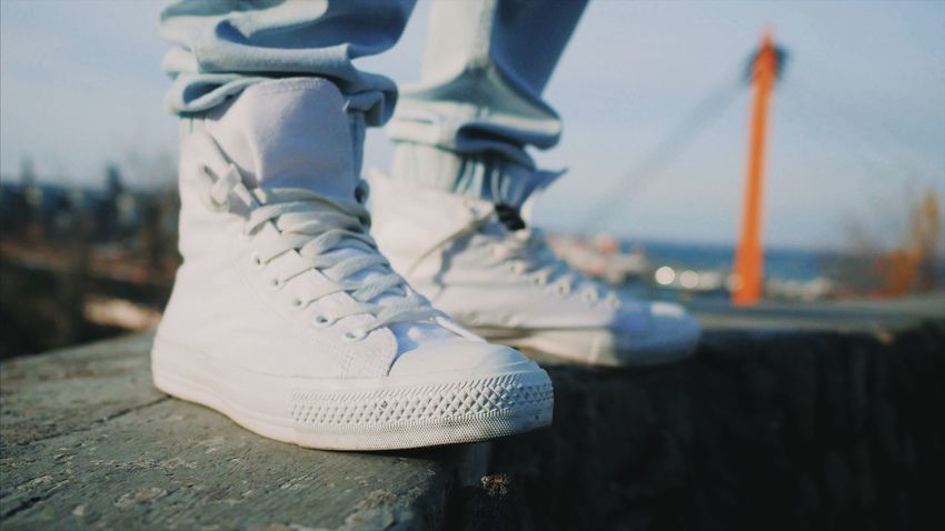 Close-up Focus On Foreground No People Outdoors Hanging Day Water Sky Ice Skate Sneakers Gumshoes Clean Clean Shoes Day Outdoor Style Real People Fashion Legs Feet