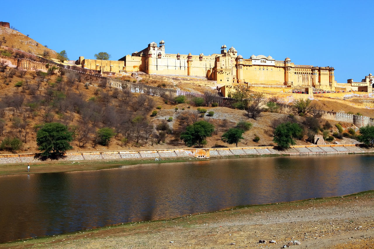 architecture, built structure, history, outdoors, building exterior, castle, river, fort, day, tree, travel destinations, water, no people, clear sky, nature, mountain, sky