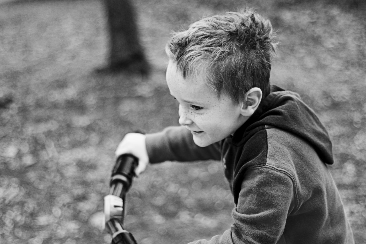 One Person Childhood Boys Real People Child Males  Archival Outdoors Day People Close-up One Boy Bike Play Monochromatic Black & White