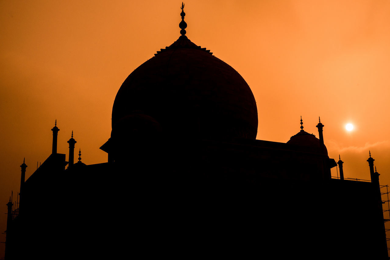 sunset, architecture, silhouette, religion, building exterior, built structure, dome, statue, spirituality, orange color, sculpture, place of worship, history, travel destinations, sky, outdoors, no people, day