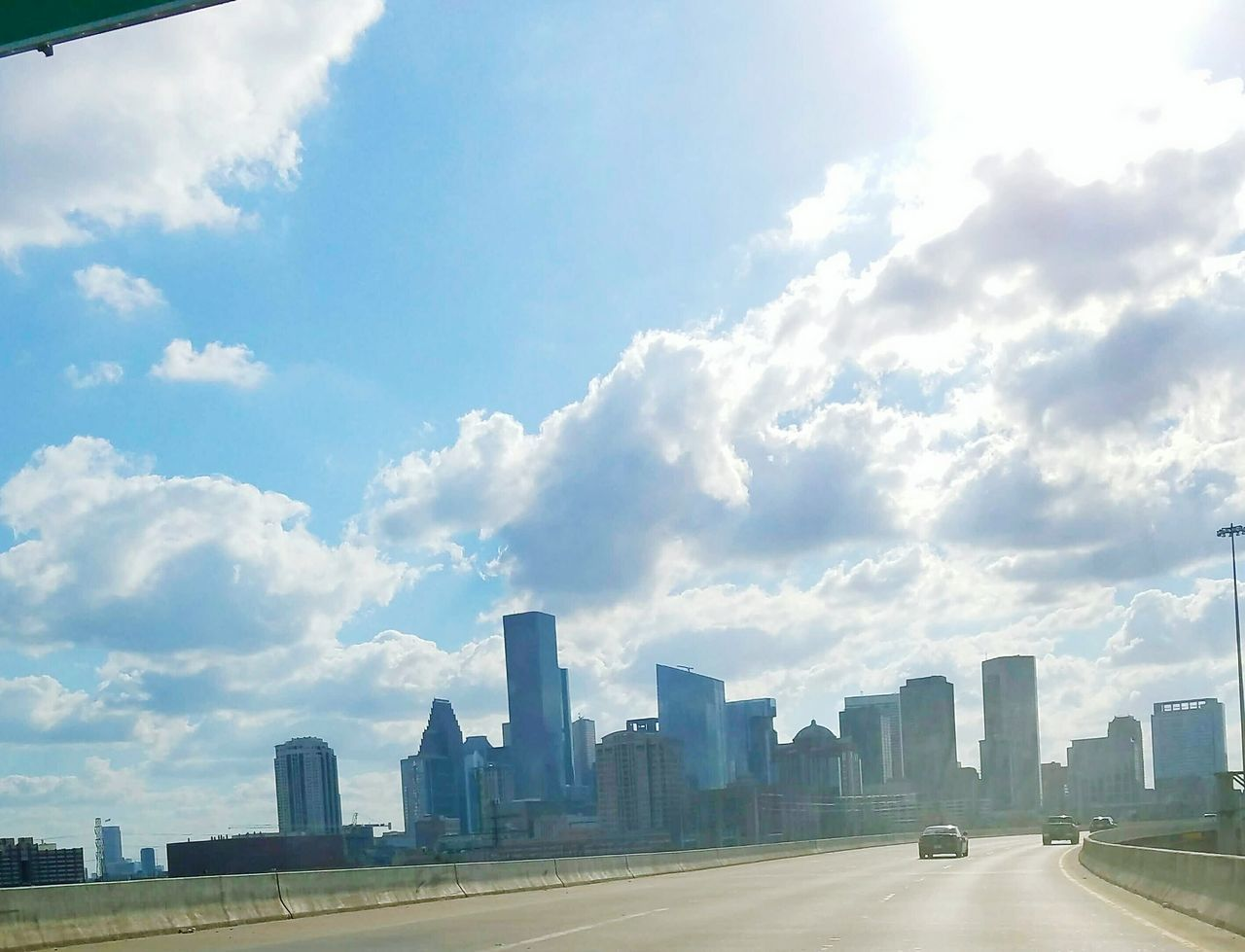 architecture, skyscraper, built structure, city, building exterior, modern, cloud - sky, urban skyline, sky, cityscape, day, outdoors, travel destinations, no people