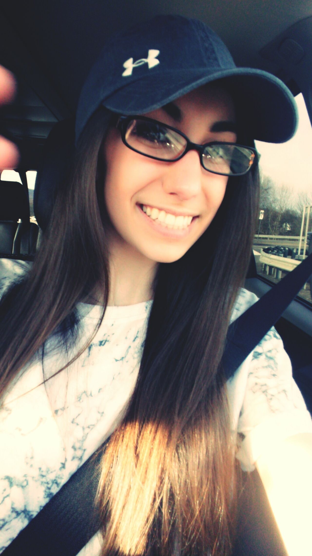 """She tried to photo bomb me lol """"why cant you just drive?!"""" Driving Smiles Long Hair Snapchat Selfienation Beautiful Happiness Lovely FaceShot Baseball Hat Baseballcap Foureyes"""