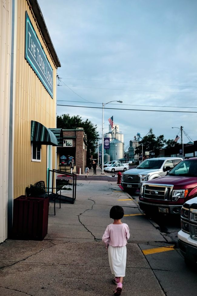 Photo essay, a day in the life. August 24, 2016 Milligan Nebraska 35mm Camera A Day In The Life Building Exterior Camera Work Composition Everyday Lives Eye For Photography EyeEm Gallery Eyeemphoto FujiX100S Little Girl Photo Essay Small Town America Small Town Stories Small Town USA Storytelling Street Fashion Street Photography Streetphotography The Way Forward Walking Around